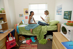 image of two female college students in a doorm room