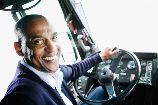 phot of a man in the driver's seat of a bus