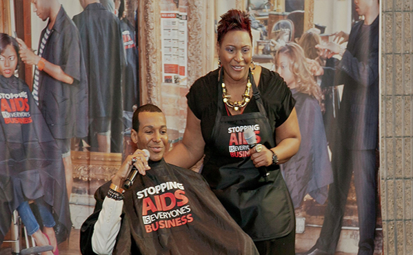 Celebrity Hairstylists - Dwight Eubanks and Kaye Flewellen - demonstrate how to engage clients in HIV prevention and education discussions while in the hair salon and barbershop at the Shop Talk Workshop