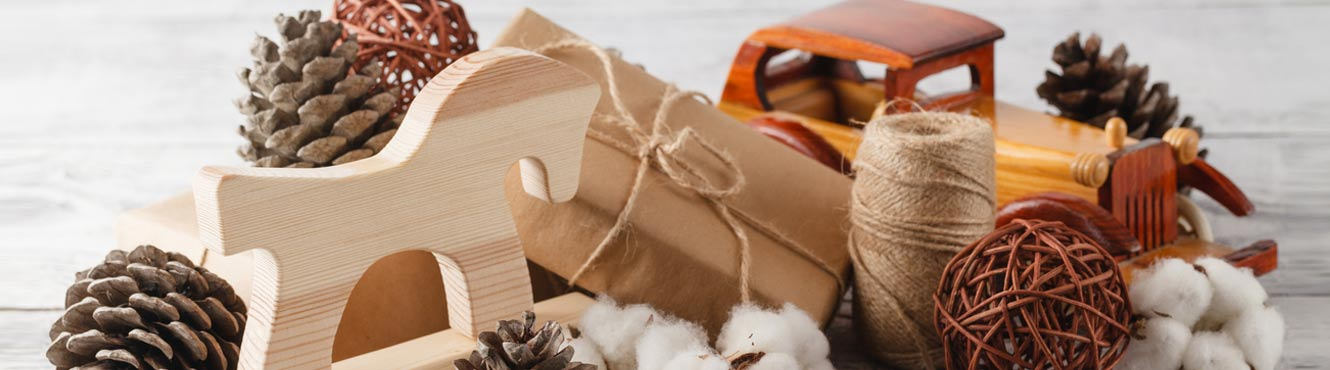 Wooden toys with brown paper wrapping paper and natural string