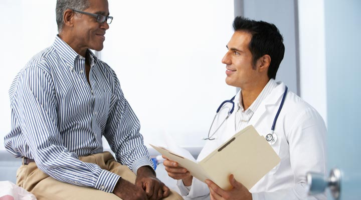 Doctor reviewing patient's medical chart with patient