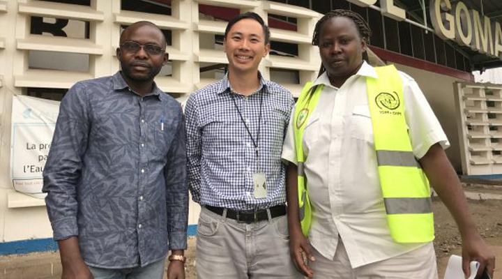 Nathan Furukawa standing with Guillaume Bahati and Dr. Clémentine Nchuti Mugisha