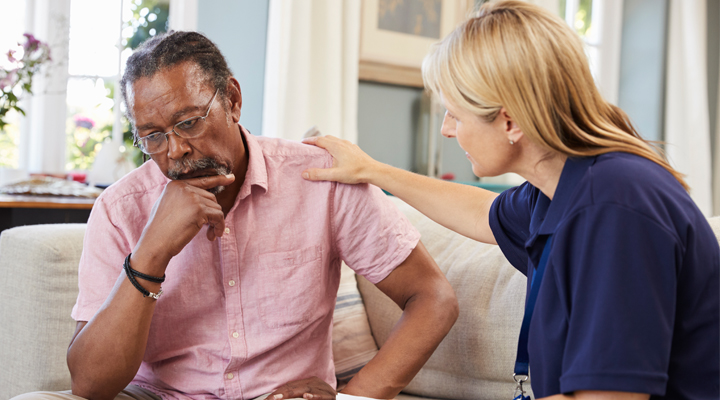 Health care providerconsoling mid-age man