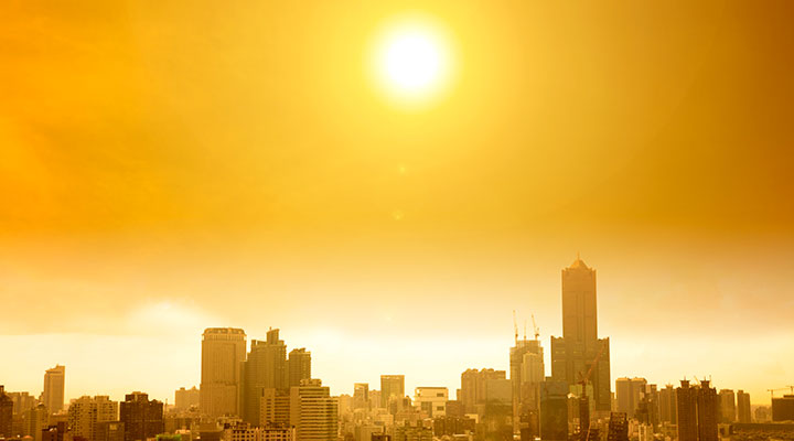 City skyline under hot sun