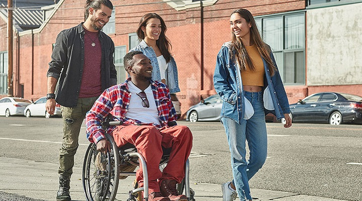 Man in wheelchair with friends