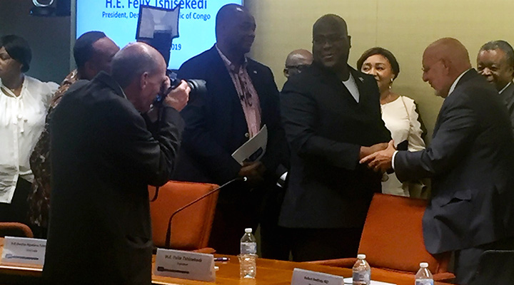Jim Gathany snaps a photo of CDC Director Dr. Robert Redfield shaking hands with Felix Tshisekedi, the president of the Democratic Republic of the Congo.