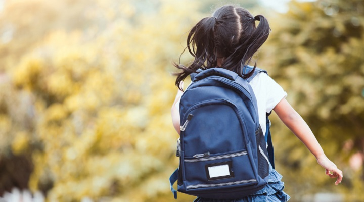 girl with backpack running and going to school