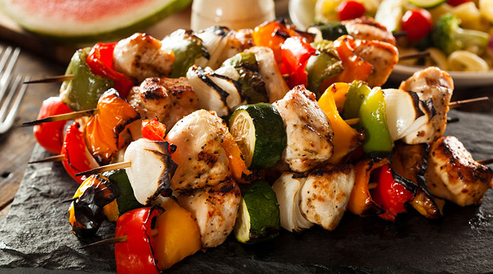 close up of cooked chicken skewers