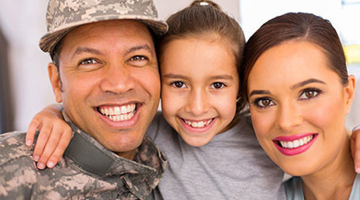 Uniformed veteran with wife and daughter