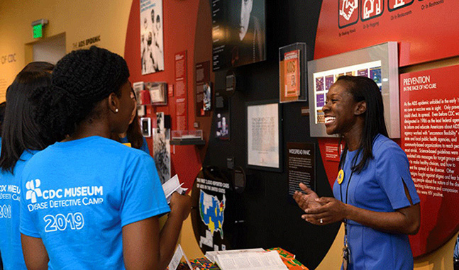 CDC employee talking to students at an event