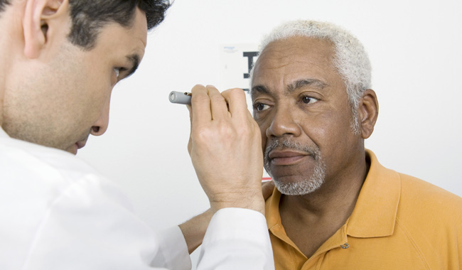 Elderly man at eye appointment