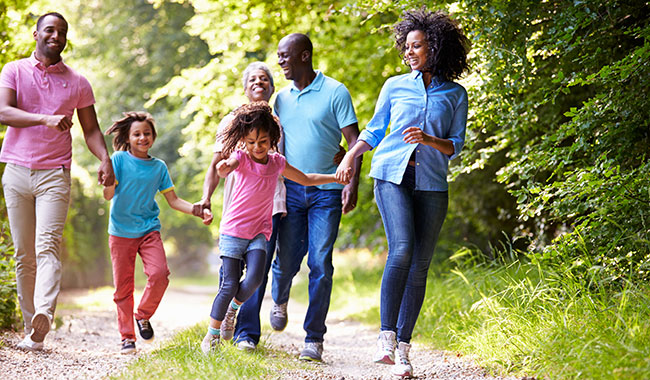 African American family running outside