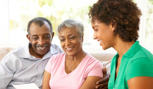 Caregiver reviewing document with older adults