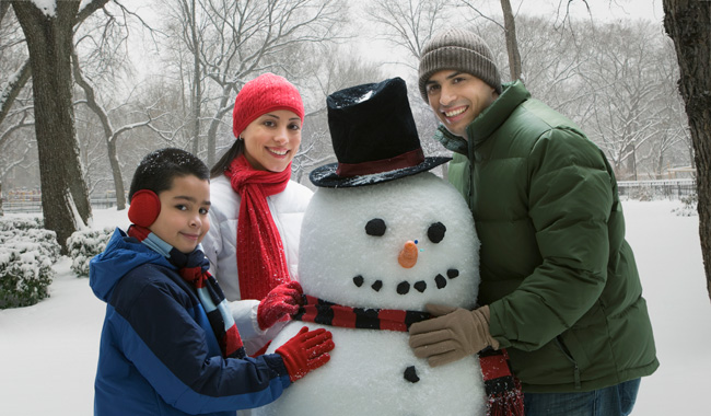 Hispanic Family making a snowman