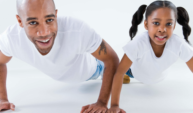 Father and daughter exercising