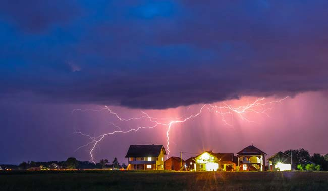 Spring storm over houses
