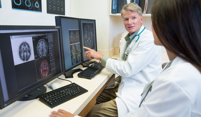 doctors reviewing brain scan images