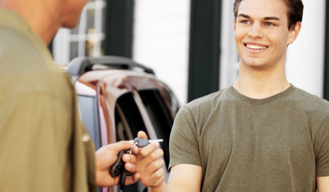 Teenager taking keys from parent