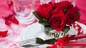 Red roses on tableware