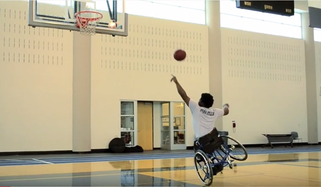 a man in a wheelchair playing basketball