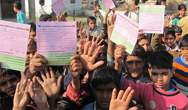 Chidlren holding their vaccination drive forms