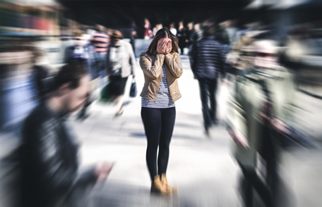 Image of a stressed woman in a crowd
