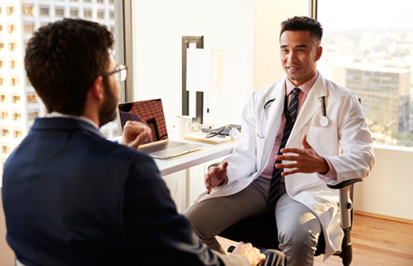 Image of a young man talking with his doctor