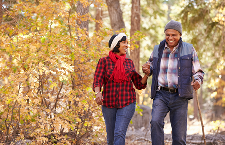 Image of a smiling couple hiking in autumn
