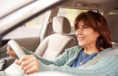 Image of a happy older woman driver