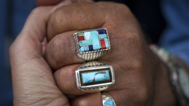 View of a hands  showing rings with Native American design
