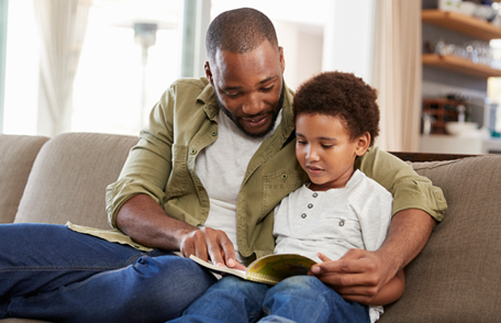 Image of a father reading to his son