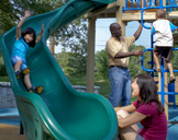 photo: adults and children on a playground