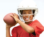 Photo: young football player wearing a helmet