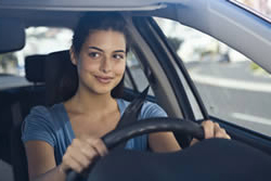 Photo: Young woman driving a car