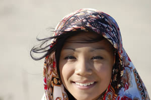 Photo: A girl wearing a head scarf