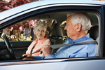 Photo: older adult couple in car