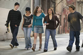 Photo: A group of teenagers walking down an urban street