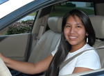 Photo: Native American teen girl behind the wheel of a car