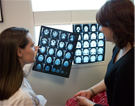 Doctors reviewing CT scans