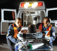 Emergency medical technicians attending to an injured person.