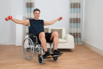 image of a man in a wheelchair lifting arm weights