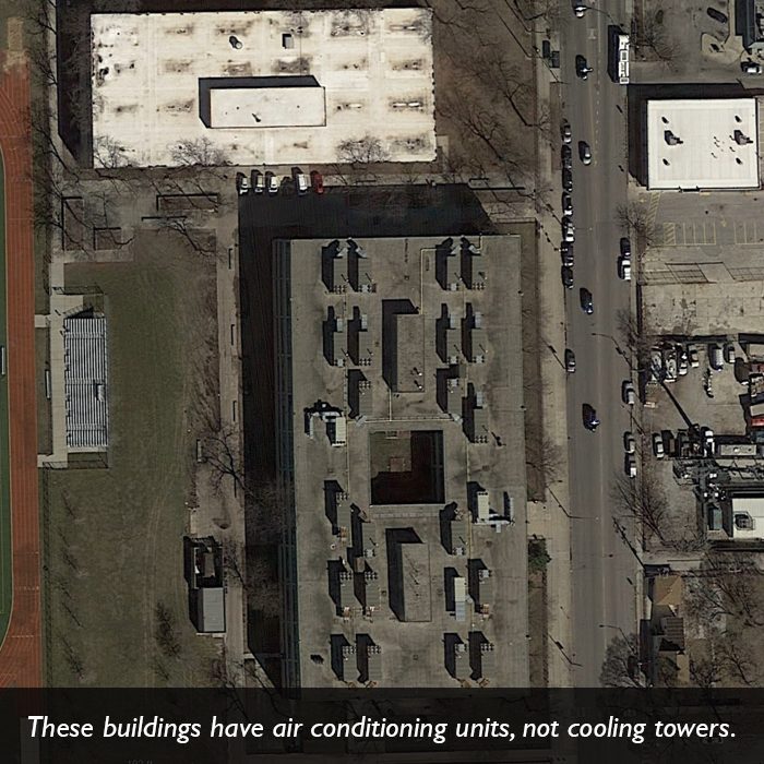 An aerial picture of several buildings that have air conditioning units, not cooling towers.