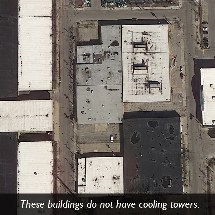An aerial picture of several buildings that do not have cooling towers.