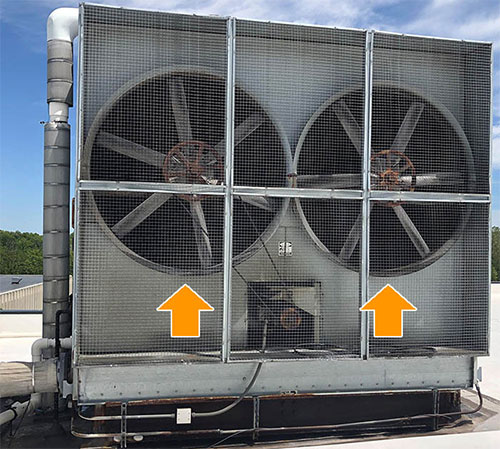 A cooling tower with side fans (highlighted with arrows), which are difficult to see from aerial photographs.