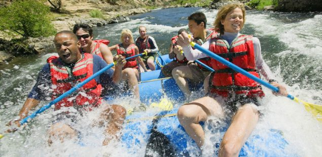 People white water rafting.