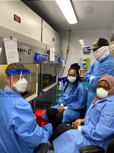 LLS fellow Stephen LaVoie (Class of 2020), far left, trains staff in a U.S. Virgin Islands public health laboratory on COVID testing instruments.