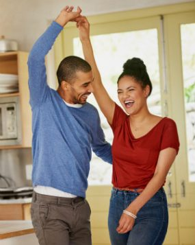 man and woman dancing in kitchen