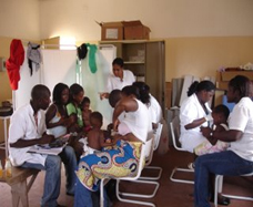 Health workers test children with fever for malaria in a busy clinic in Luanda, the capital of Angola.