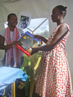 A pregnant woman receives a treated mosquito net during the Intermittent Preventive Treatment of Malaria in Pregnancy Trial in Kenya's Siaya District Hospital.