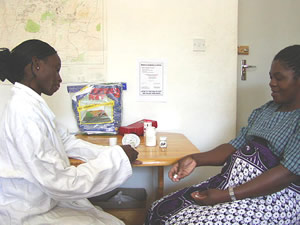 pregnant woman during a prenatal consultation receives sulfadoxine-pyrimethamine.
